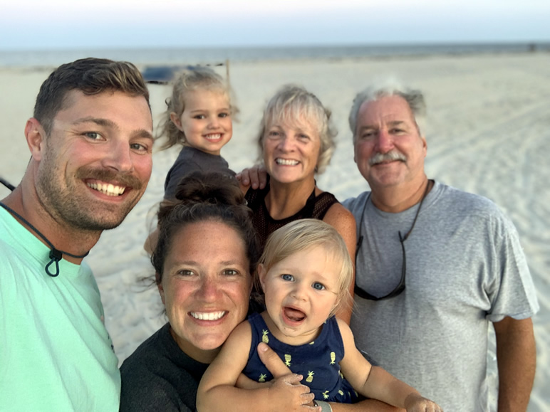 Jennie with her family at the beach