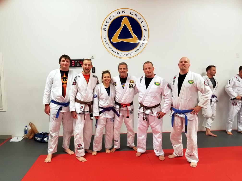 Jessica with team members in her Brazilian Jiu Jitsu clothes
