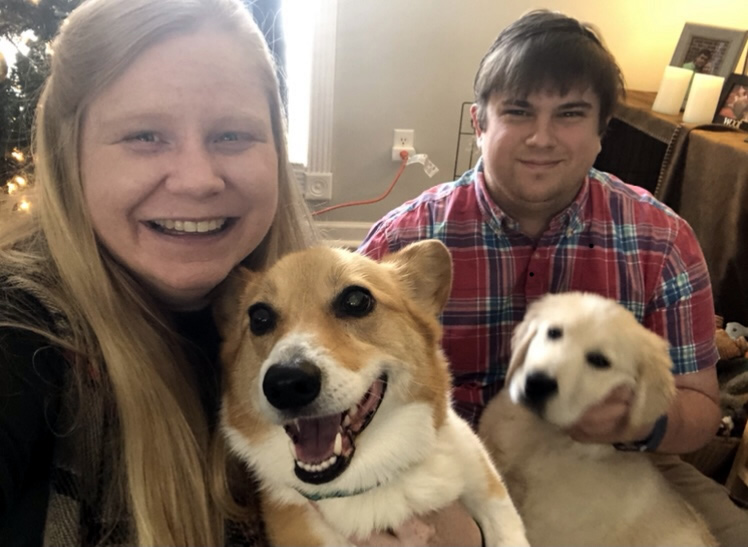 Sarah, her husband and two dogs