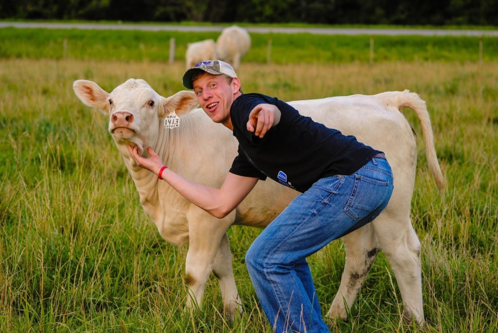 Troy posing with a cow