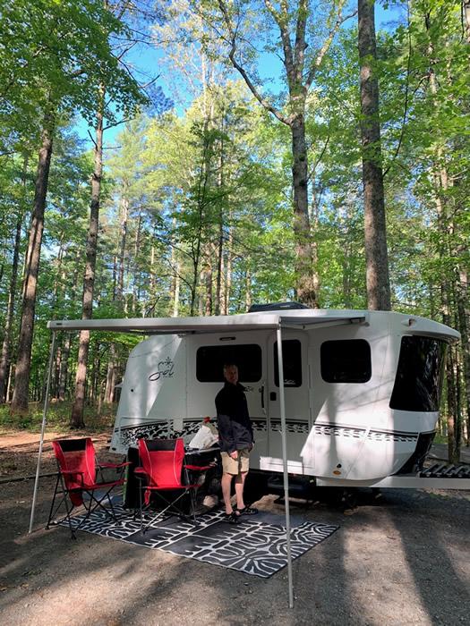 a camper in the woods