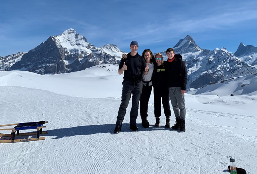 Brynn and family on top of a mountain