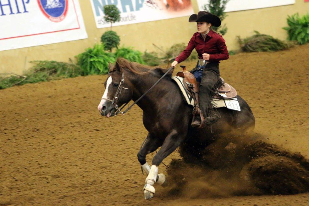 Delaney riding a horse in competition