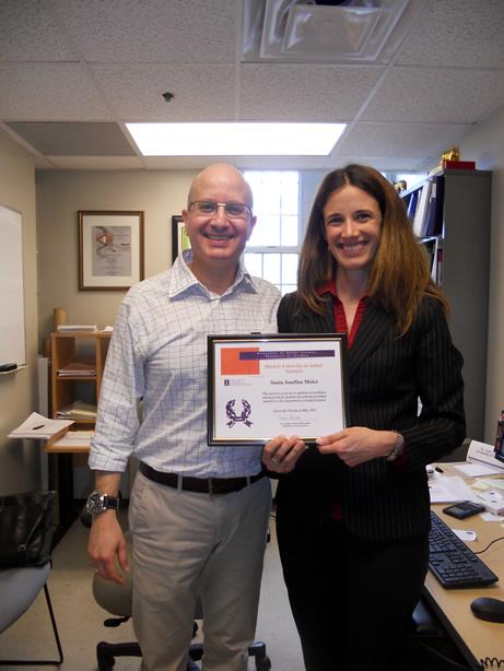 Sonia receiving an award