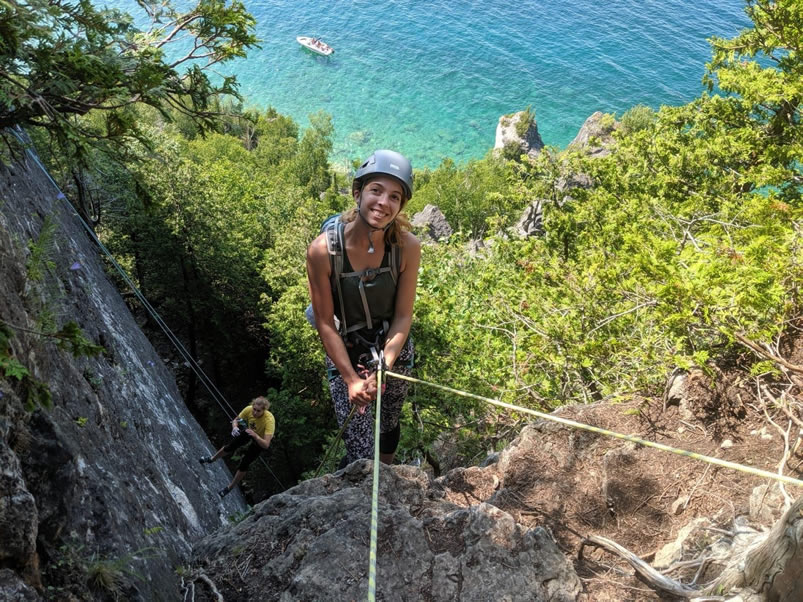 Casey repelling a cliff