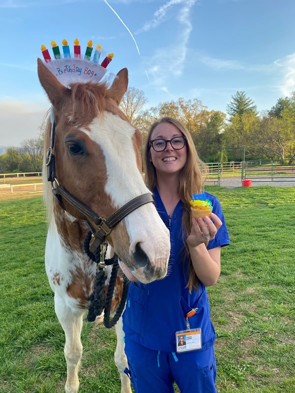 Emma with a horse celebrating it's birthday