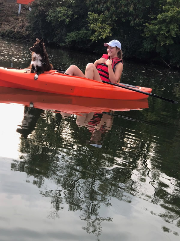 Emma and dog kayaking