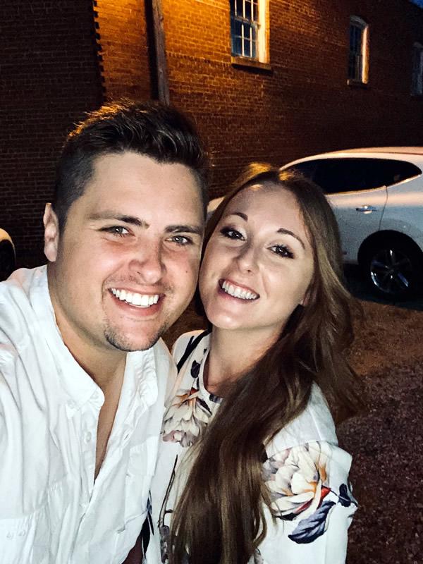 Emma posing with a man