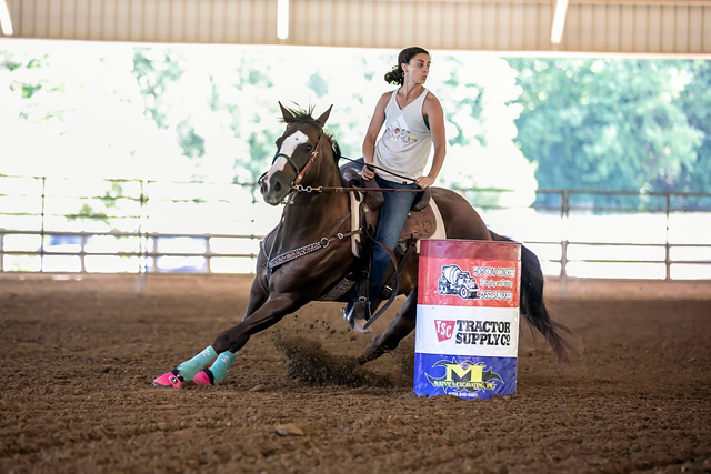Amanda riding a horse in a competition