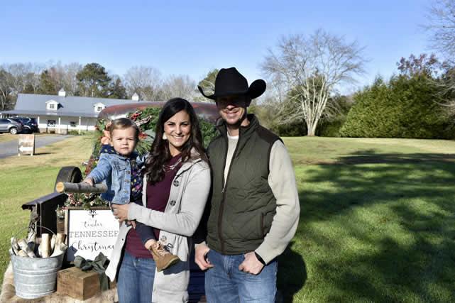 Amanda with her husband and child