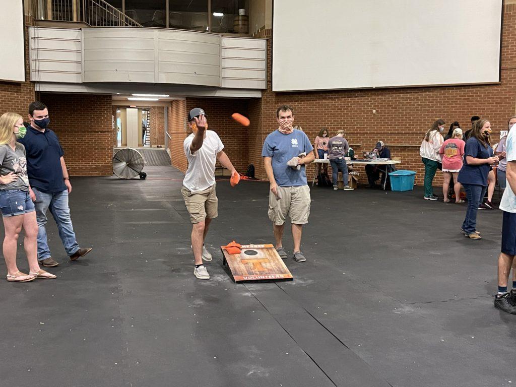 Students playing cornhole