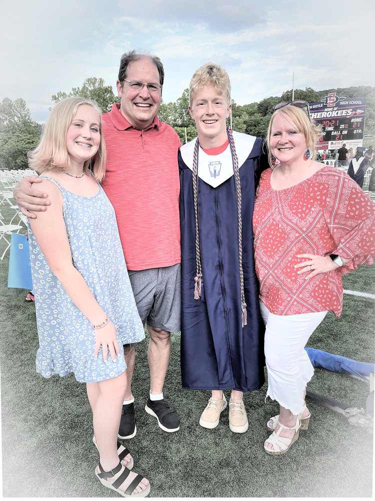 Shelly and her family at her sons high school graduation