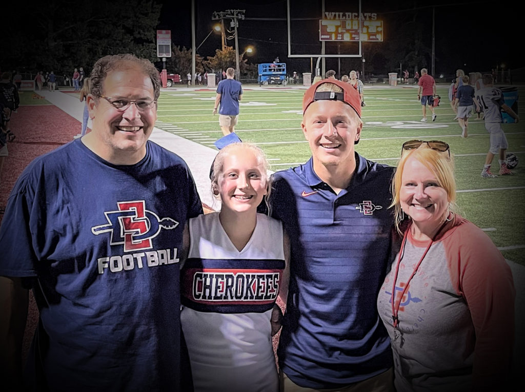 Shelley with her family at a high school football game