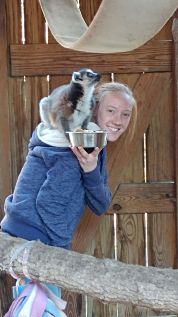 Caitlin with a Ringtail Lemur on her shoulder
