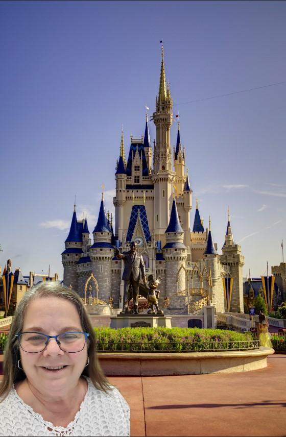 Brenda in front of the castle in Disney World