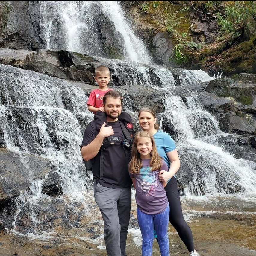 Brenda's daughter and family in front of a waterfall